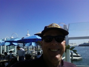 Me at Long Beach Pier on March 08, 2015, You can see part of the Queen Mary on the right and a modern Cruise Ship on the left,