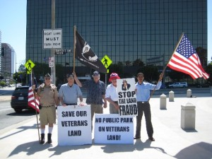 Terry Richards, Robert Rosebrock, et al Demonstrating with Veterans Homes Advocates during the Memorial Day Rally on Sunday May 29, 2012 just outside of Wilshire and San Vicente West Los Angeles VA Gate before I found out that 80% of homeless Veterans do not want to live in Veterans Homes on VA Property. They want to live in HUD-VA Section 8 Private Independent Housing… Looking at the photo I am second from the left and Robert Rosebrock who turned-out to be a very Demonic individual is third from the left next to me holding the black MIA Flag…