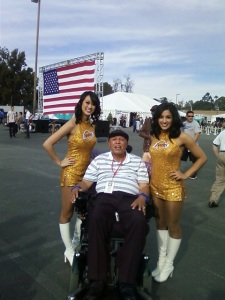 73-year old Veteran and Resident of the Veterans Home of California West Los Angeles John Smith poses with LAKERS Cheerleaders who Volunteered to pose with Veterans.