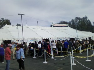 100's of Veterans, some with Members of their Family wait on line by the tent where they will be served a Gourmet Meal.