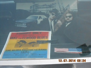 """""""Blues Brothers"""" poster with John Belushi and Dan Akroyd inside of Police Car."""
