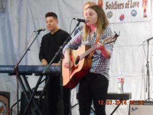 Jami Bess Belushi sing for Veterans.