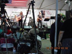 Proud Father Jim Belushi watching his Daughter Jami Bess Belushi sing and play guitar.