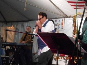 Dan Akroyd making his entrance playing the Harmonica.